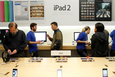 Customers look at the iPod and iPad 2 at the Apple retail store in San Francisco