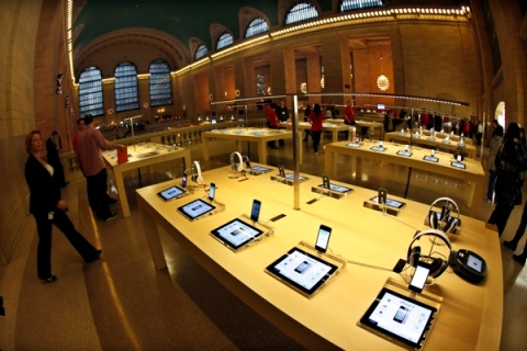 Apple iPad tablets and iPhones are seen on display inside the newest Apple Store in New York City's Grand Central Station during a press preview