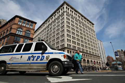 A New York Police Department van passes near 770 Broadway, t