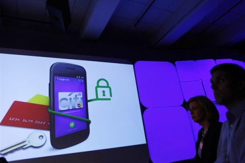 Attendees watch a demonstration of the Google wallet application during a news conference unveiling the mobile payment system in New York