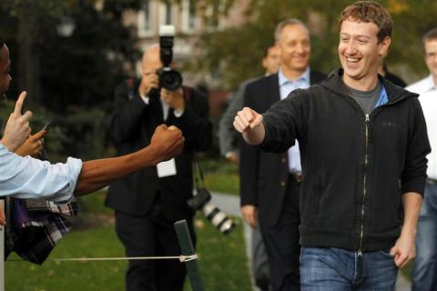 Mark Zuckerberg fist bumps a student at Harvard University in Cambridge