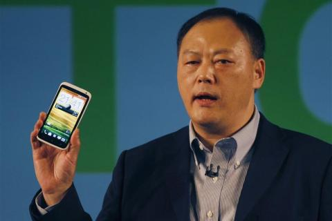 HTC's President and CEO Peter Chou poses with new HTC One