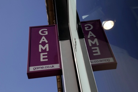 A sign outside a Game store is seen in central London