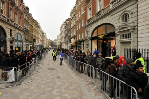 Customers wait to purchase Apple iPad tablet computers in Covent Garden in central London