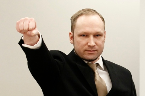 Breivik clenches his fist as he arrives to courtroom for the first day of his trial  in Oslo