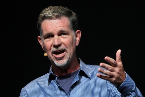 Netflix CEO Reed Hastings gestures while speaking at the Facebook f8 Developers Conference in San Francisco