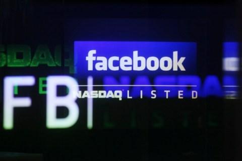 Facebook logo is seen on a screen inside at the Nasdaq Marekstsite in New York
