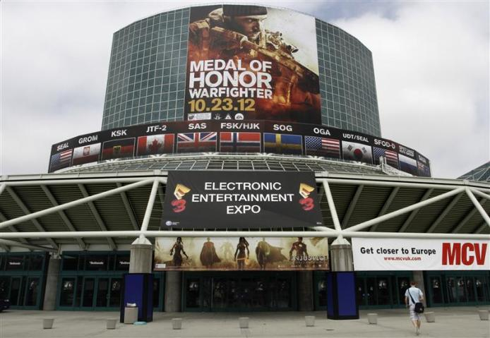 A man walks past signs in place for E3 2012