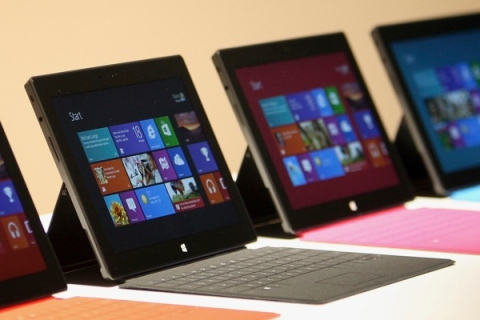 New Surface tablet computers with keyboards are displayed at its unveiling by Microsoft in Los Angeles