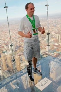 Vawter celebrates after climbing to the top of the 103-story Willis Tower using the world's first neural-controlled Bionic leg in Chicago