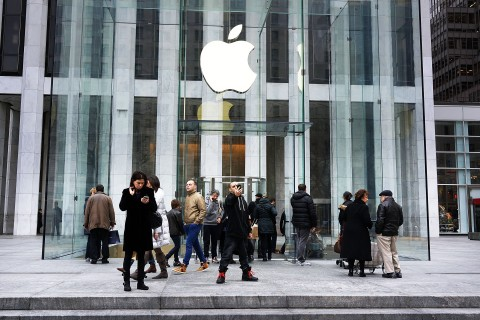 People walk in front of the 5th avenue Apple store on Jan. 14, 2013 in New York City.