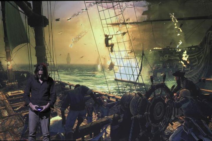 A game developer demonstrates Assassin's Creed IV Black Flag at the Sony news conference show on the eve of the opening of E3, the Electronic Entertainment Expo, in Los Angeles