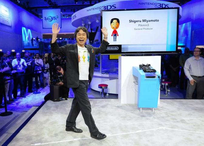 """Japanese video game designer Miyamoto takes the stage to introduce """"Pikmin 3"""" during the Wii U Software Showcase at E3 in Los Angeles"""