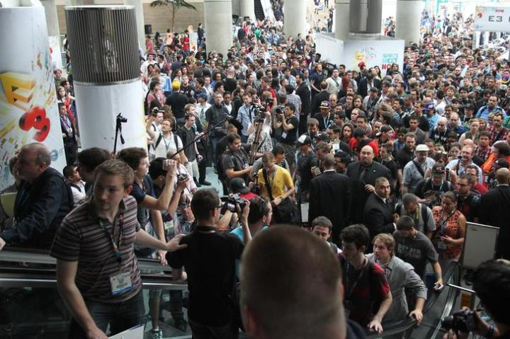 People enter an exhibition hall as doors open on the first day of E3, the Electronic Entertainment Expo, in Los Angeles, California.