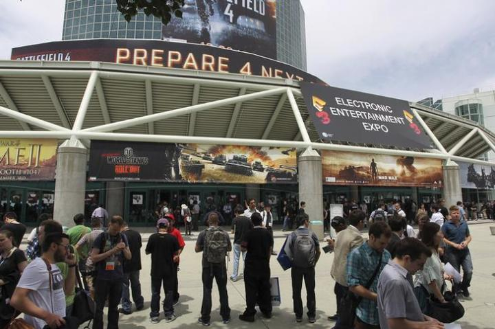People wait for doors to open on the first day of E3, the Electronic Entertainment Expo, in Los Angeles, California