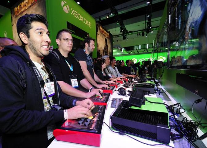 Gamers try out the new Xbox One with a third party controller during E3 in Los Angeles