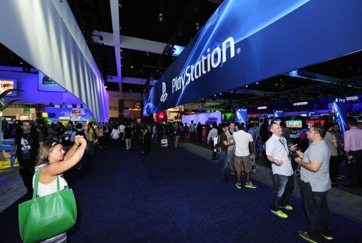 People photograph the Sony Playstation booth at E3 in Los Angeles, California
