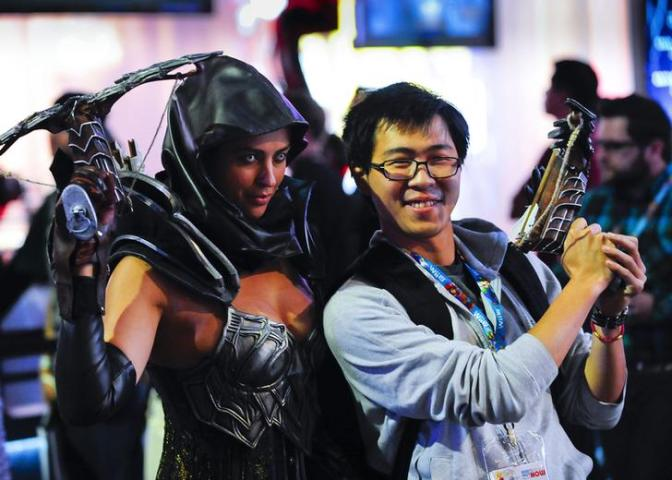 Visitor poses with actor reprised as a game character during E3 in Los Angeles