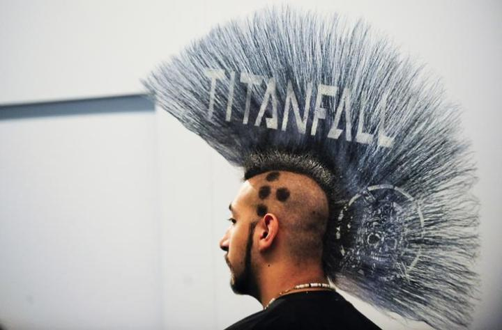 """Branding of a new Electronic Arts game """"Titanfall"""" is displayed on the mohawk of a man during E3 in Los Angeles"""