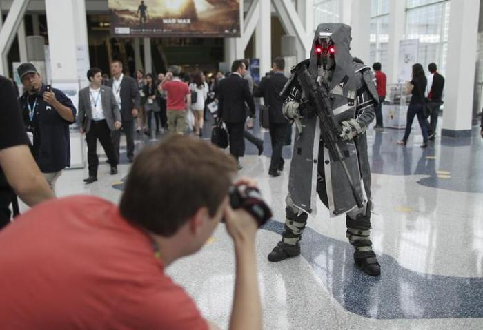 """Attendee photographs Helghast sniper character from PS4 game """"Killzone: Shadow Fall"""" at E3, the Electronic Entertainment Expo, in Los Angeles"""