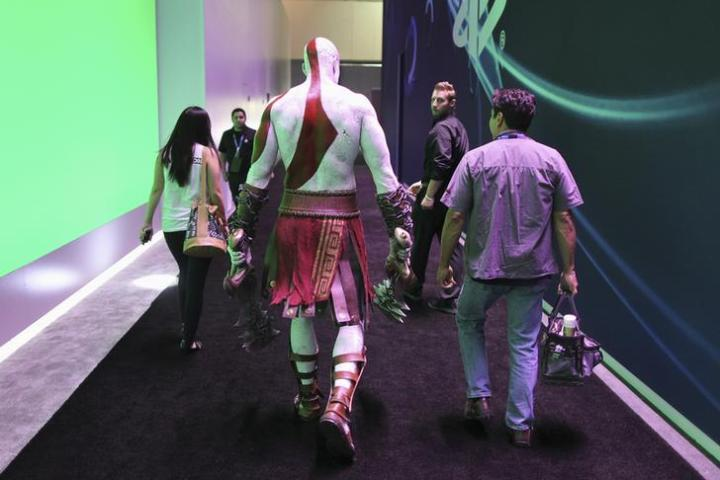 A man playing the role of the character Kratos of the Sony game, God of War, walks the exhibit floor at E3, the Electronic Entertainment Expo, in Los Angeles