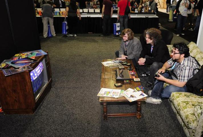 Gamers play Pac Man on an Atari game console during E3 in Los Angeles