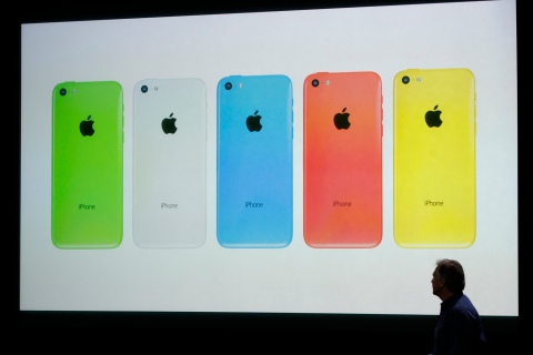 The five colors of the new iPhone 5C are seen on screen at Apple Inc's media event in Cupertino