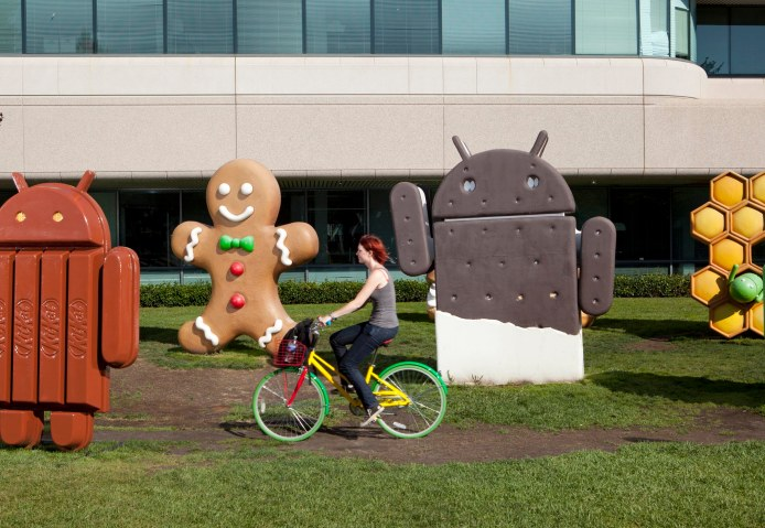 mg_7193An employee rides a Google bicycle past Android-themed statues.
