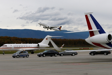 The aircraft of Germany's Foreign Minister Westerwelle arrives next to French Foreign Minister Fabius aircraft in Geneva