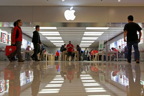 Black Friday shoppers walk past an Apple Store inside the Glendale Galleria in Glendale, California