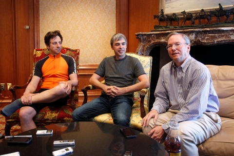 Google Chairman and CEO Eric Schmidt speaks beside co-founders Sergey Brin and Larry Page at the Sun Valley Inn in Sun Valley