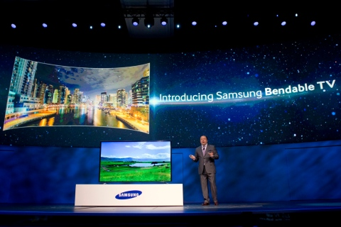 Joe Stinziano, executive vice president of Samsung Electronics of America, introduces a bendable television during the Consumer Electronics Show (CES), in Las Vegas