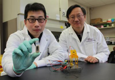 Y.H. Percival Zhang (right), an associate professor of biological systems engineering at Virginia Tech, and Zhiguang Zhu show off their new sugar battery.